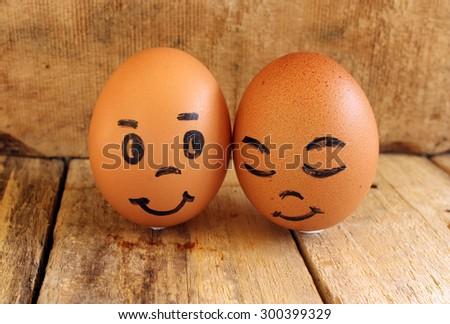 Eggs on wood background - stock photo