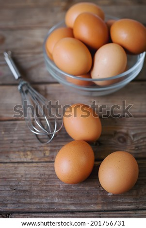 Eggs on  wooden background,