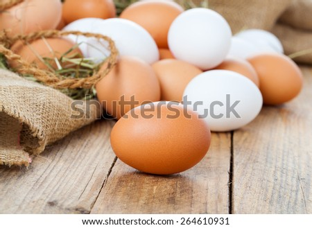 Eggs on wooden background - stock photo