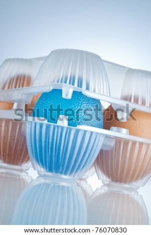 eggs package, the blue egg stands for genetically modified organism food - stock photo