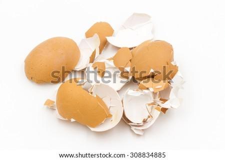 Eggs shell on white background - stock photo