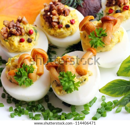 Eggs stuffed with boiled egg yolk, fried onions and mushrooms - stock ...