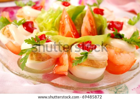 eggs stuffed with tuna spread and mayonnaise on easter table