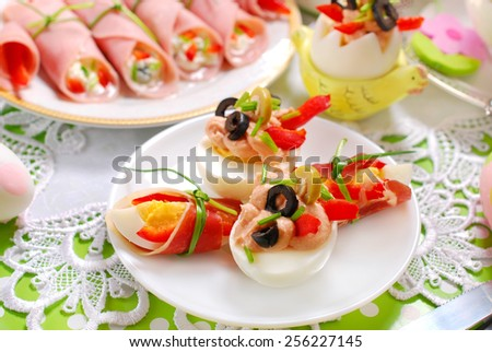 eggs stuffed with tuna spread and olives as appetizer for easter breakfast  - stock photo