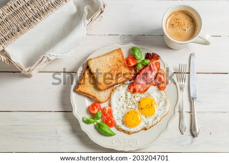 Eggs, toast and bacon for breakfast - stock photo