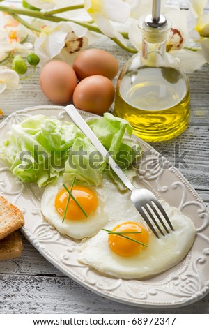 eggs with green salad on dish