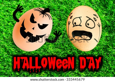 Eggs with Halloween funny faces, excited action isolated on green grass background texture - stock photo
