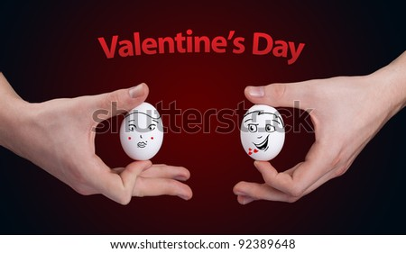 Eggs with happy smiley faces on valentines day theme