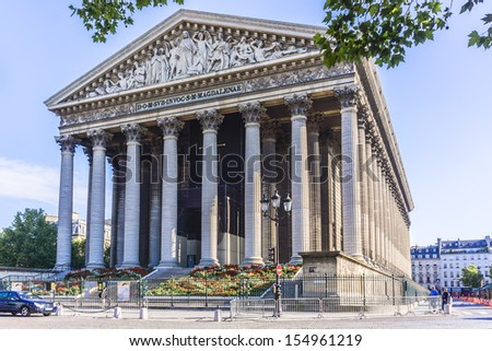 Eglise de la Madeleine, one of most famous churches of Paris, France. Madeleine Church was designed in its present form as a temple to the glory of Napoleon's army. - stock photo