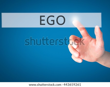 Ego - Hand pressing a button on blurred background concept . Business, technology, internet concept. Stock Photo