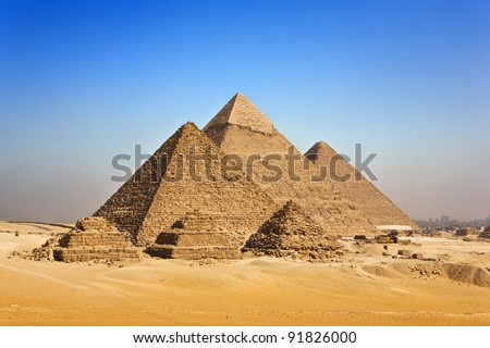 Egypt. Cairo - Giza. General view of pyramids from the Giza Plateau (in order from left: the Pyramid of Menkaure /Mykerinos/, Khafre /Chephren/ and Chufu /Cheops/ - known as the Great Pyramid - stock photo