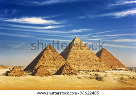 Egypt. Cairo - Giza. General view of pyramids from the Giza Plateau (three pyramids known as Queens' Pyramids on front side; next in order from left: the Pyramid of Menkaure, Khafre and Chufu - stock photo