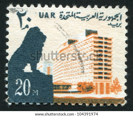 EGYPT - CIRCA 1964: stamp printed by Egypt, shows Lion and Nile Hilton Hotel, circa 1964