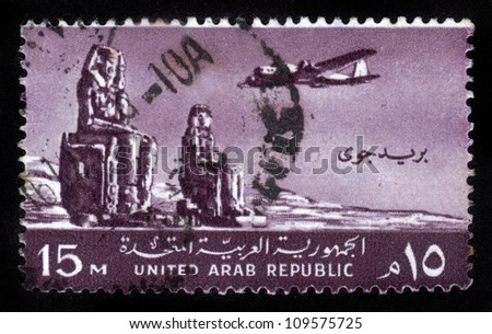 EGYPT - CIRCA 1959: stamp printed by Egypt ( united arab republic ) , shows Plane, Colossi of Memnon, Thebes, circa 1959