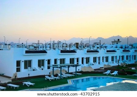 Egypt evening view on hotel and mountains with sunset - stock photo