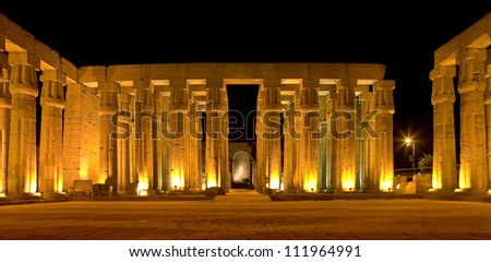 Egypt. Illuminated Luxor Temple. The Peristyle Court of Amenhotep III and Hypostyle Hall - stock photo