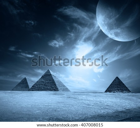 Egypt pyramids on a black sky with moon. Elements of this image furnished by NASA. - stock photo