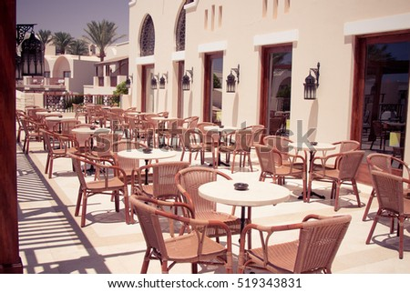 EGYPT, Sharm El Sheikh -July 23, 2015: Outdoor Restaurant Coffee Open Air Cafe,  Chairs with Tables, Summer Vacation on Tropical luxury Resort
