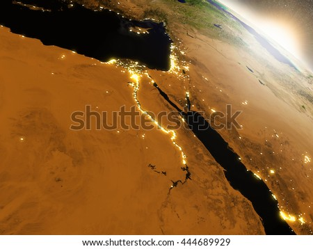 Egypt with surrounding region during sunrise as seen from Earth's orbit in space. 3D illustration with realistic planet surface, clouds and city lights. Elements of this image furnished by NASA.