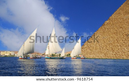 Egyptian Abstraction - Falukas on the Nile and Egyptian Pyramid fantasy - stock photo