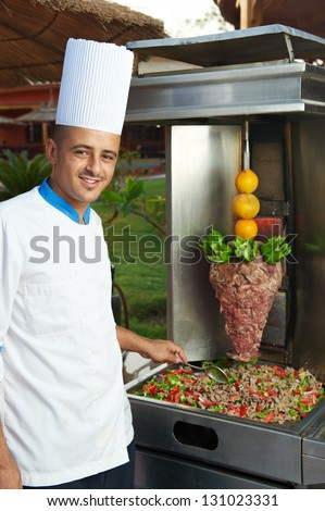 Egyptian arab chef in cook uniform making kebab with meat and vegetables - stock photo