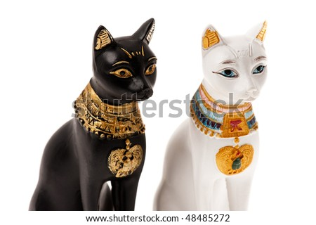 Egyptian Bastet statues isolated on white - stock photo