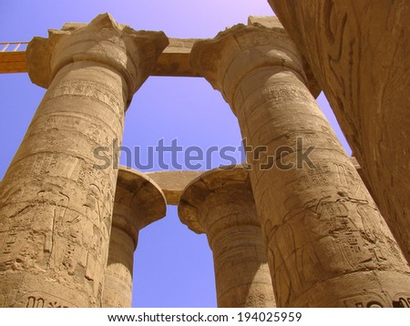 Egyptian columns with hieroglyphs at Karnak Temple, Luxor - stock photo