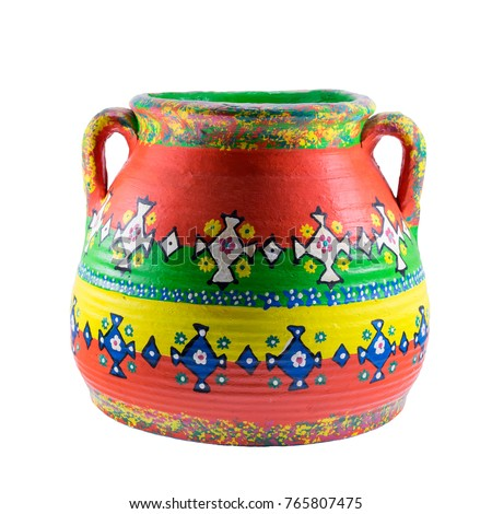 Egyptian decorated colorful painted pottery vase isolated on white