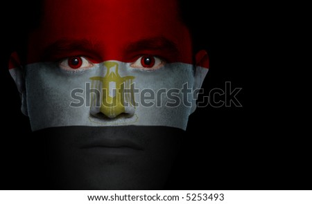 Egyptian flag painted/projected onto a man's face. - stock photo