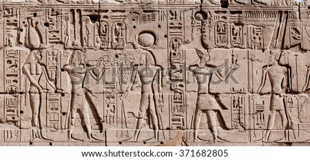 Egyptian hieroglyphs. Hieroglyphic carvings on a wall