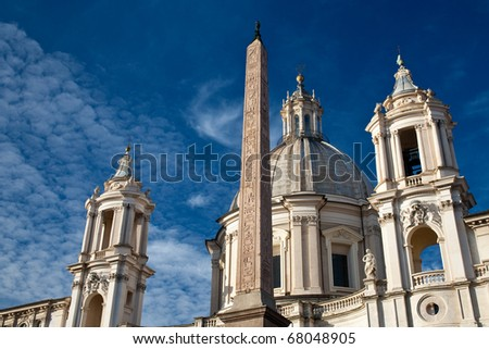Egyptian obelisk and buildings  on piazza Navona - stock photo