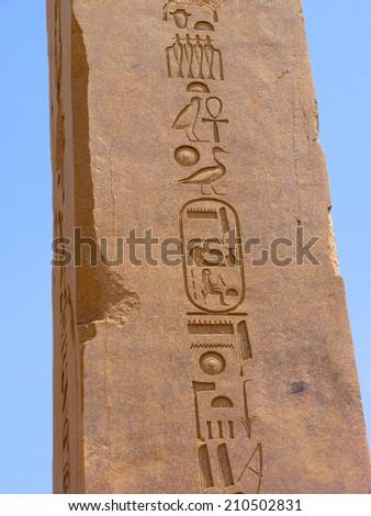 Egyptian obelisk with hieroglyphs at Karnak Temple, Egypt - stock photo