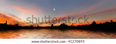 Egyptian panorama with Giza Pyramids, Cairo Citadel, Mosque, Church and palm trees on the Nile river during sunset - stock photo