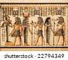 Egyptian papyrus showing the Pharaoh Tutankhamen and gods Osiris, Hathor and Isis - stock photo