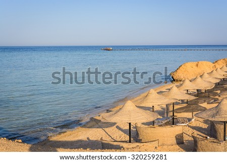 Egyptian parasols on the beach of Red Sea - stock photo