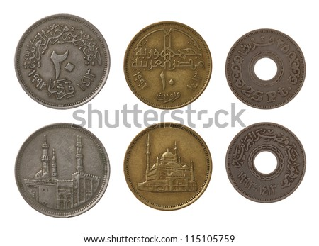 Egyptian piastres or qirsh coins isolated on white - stock photo