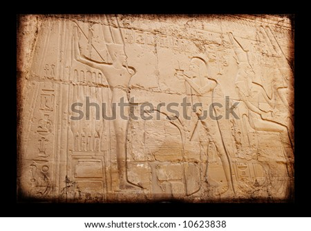 Egyptian sings on the wall, background - stock photo