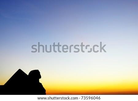 Egyptian sphinx and pyramid - stock photo