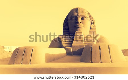 Egyptian sphinx - modern sandy sculpture in an old tradition of Egypt. Egyptian pharaons in art, travel in Africa. - stock photo