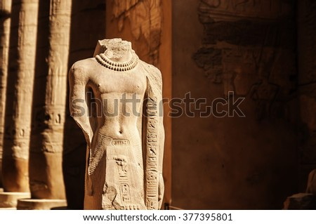 Egyptian Statue with hieroglyphic carvings - stock photo