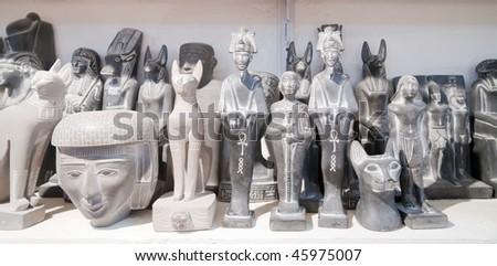 egyptian  stone souvenir on counter at shop - stock photo