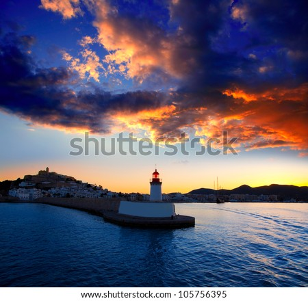 Eibissa Ibiza town sunset from red lighthouse beacon in port - stock photo