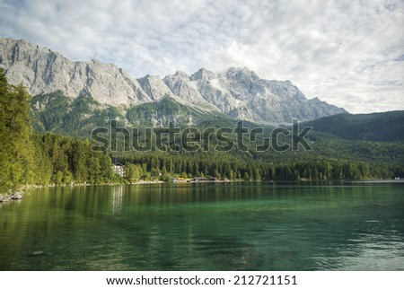 Eibsee lake and the Zugspitze, at 2,962 meters above sea level, is the highest peak of the Wetterstein Mountains as well as the highest mountain in Germany, Europe - stock photo