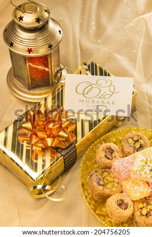 "Eid festival gift set up with ""Eid mubarak' card displayed. - stock photo"