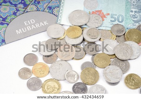 Eid fitr envelop , bank notes and coins  isolated on white. Business concept. DOF and copy space.  - stock photo