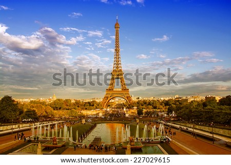 Eiffel Tower and fountain at Jardins du Trocadero at sunset in Paris, France. Travel background - stock photo