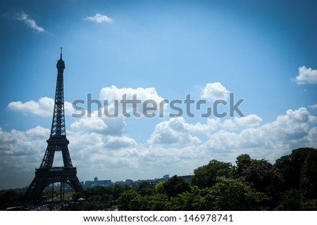 Eiffel tower and landscape. Shadowed angles.