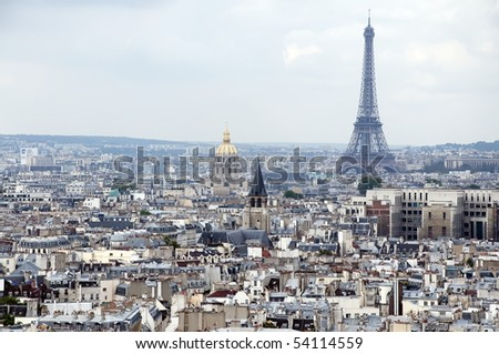 Eiffel tower and Paris roofs. Overcast sky. Paris, France, Europe - stock photo