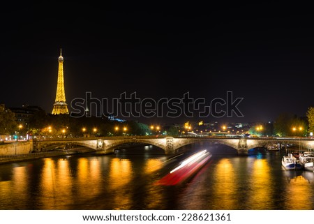 Eiffel Tower and Seine river at night - stock photo