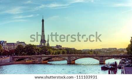 Eiffel tower and Seine river Panoramic view of city of Paris with Eiffel tower and bridge over Seine river, France. - stock photo